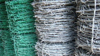 Galvanized Barbed Wire as Modern Security Fence is Widely Used.